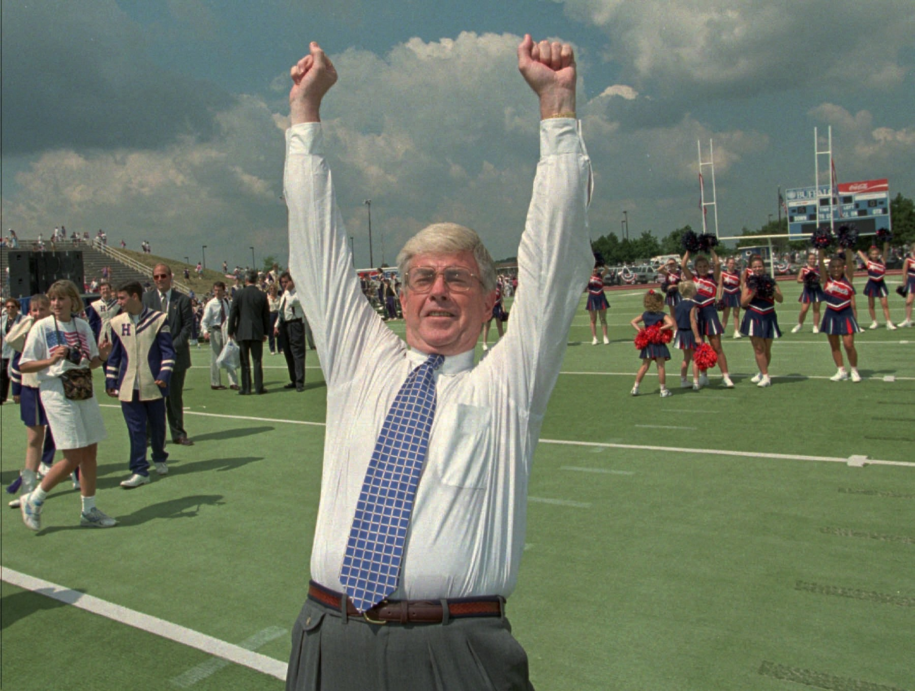 Republican vice presidential candidate Jack Kemp celebrates a pass completion to his former Buffalo Bills teammate, tight end Charlie Ferguson, during a campaign rally with Bob Dole Sunday, Aug 18, 1996, at the old football stadium on the State University of New York campus at Buffalo, N.Y.  (AP Photo/Bill Sikes)
