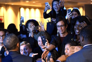 President Barack Obama greets people after speaking at the Democratic National Committee 22nd Annual Women's Leadership Forum / AP