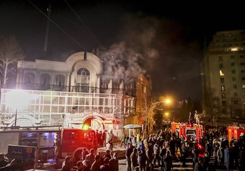 Smoke rises as Iranian protesters set fire to the Saudi embassy in Tehran