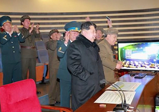 Kim Jong Un reacts to North Korea's missile launch