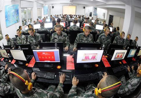 Chinese soldiers browse online news on desktop computers at a garrison of the PLA