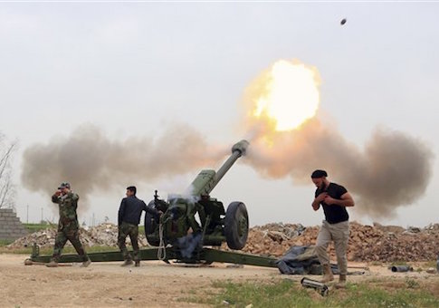 Iraqi security forces fire at ISIS militants positions from villages south of Mosul /