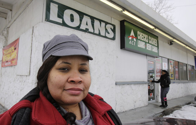 Maranda Brooks stands outside a payday loans business that she frequented in the past Thursday, Jan. 22, 2015, in Cleveland. Troubled by consumer complaints and loopholes in state laws, federal regulators are putting together expansive, first-ever rules on payday loans aimed at helping cash-strapped borrowers from falling into a cycle of high-rate debt. Analysts often point to Ohio for its complicated history with payday loans: Ranking fourth in the nation in the share of people who took out payday loans, at 10 percent, Ohio also was third among states in the number of consumer complaints to the CFPB about payday loans, behind Texas and California. (AP Photo/Tony Dejak)
