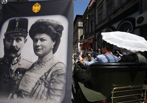 Tourists pose for photos near the street corner in downtown Sarajevo where Franz Ferdinand was assassinated