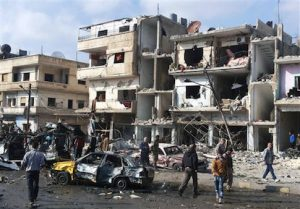 Syrian citizens gather at the scene where two blasts exploded in the pro-government neighborhood of Zahraa, in Homs province, Syria in Feb. 2016 / AP