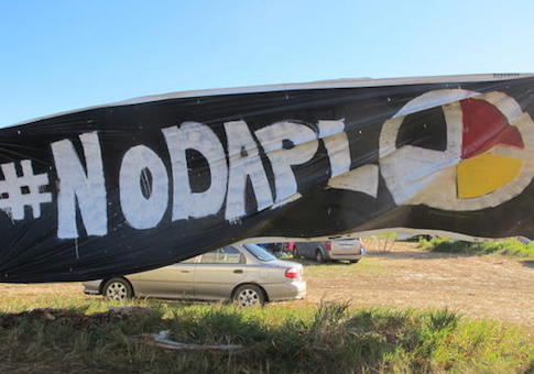 A banner protesting the Dakota Access oil pipeline is displayed at an encampment near North Dakota's Standing Rock Sioux reservation
