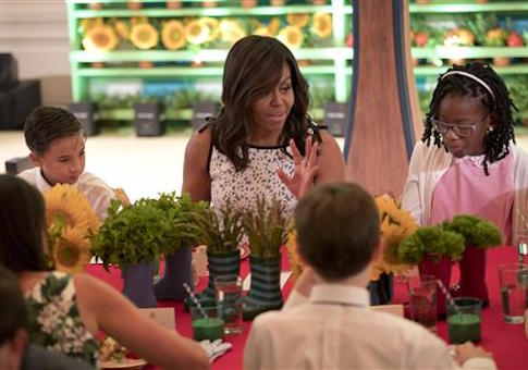 Michelle Obama sits with winners of 2016 Kids' Healthy Lunchtime Challenge in the East Room of the White House