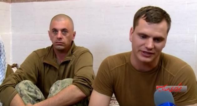 Lt. David Nartker, right, talks with his Iranian captors