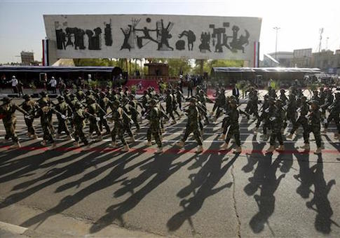 Iraqi government-backed Popular Mobilization forces take part in a joint military parade with Iraqi security forces in Baghdad