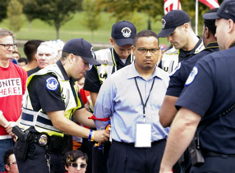 Rep. Keith Ellison (D., Minn.) arrested by U.S. Capitol Police on Capitol Hill during immigration rally in Washington, Oct. 8, 2013 / AP