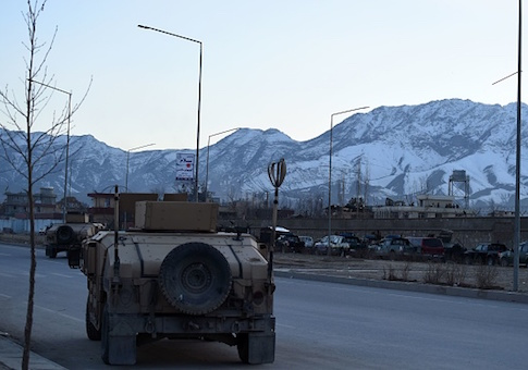 Afghan security forces arrive at the site of a suicide car bombing that targeted an Afghan police district headquarters building