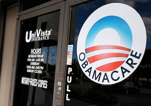 An Obamacare logo is shown on the door of the UniVista Insurance agency in Miami