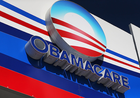 An Obamacare sign is seen on the UniVista Insurance company office
