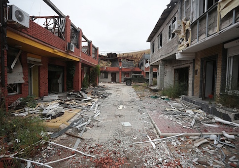 The town of Shyrokyne, in the Donetsk region, shows a street with buildings destroyed by pro-Russian separatists shelling