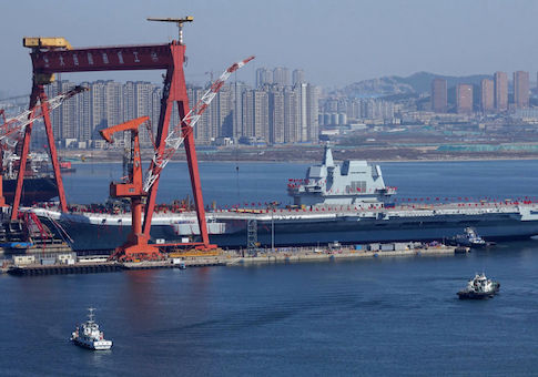 China's homegrown aircraft carrier is transferred from the dry dock into the water during a launch ceremony at Dalian shipyard