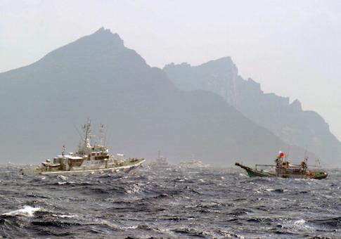 A Taiwan fishing boat and a Japan Coast Guard vessel are seen near the Senkaku islands