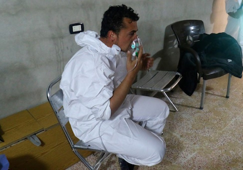 A man breathes through an oxygen mask, after what rescue workers described as a suspected gas attack in the town of Khan Sheikhoun in rebel-held Idlib