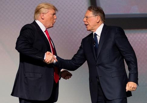 US President Donald Trump shakes hands with National Rifle Association (NRA) President Wayne LaPierre