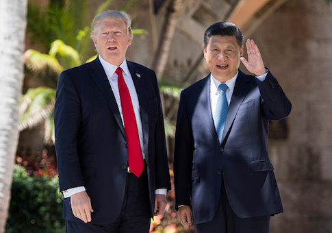 Chinese President Xi Jinping waves to the press as he walks with US President Donald Trump at the Mar-a-Lago estate in West Palm Beach, Florida
