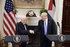 U.S President Donald Trump shakes hands with President Mahmoud Abbas of the Palestinian Authority after a joint statement in the Roosevelt Room of the White House