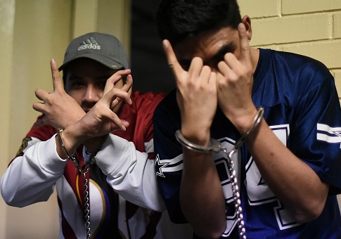 Members of MS-13 flash their gang gesture / Getty Images