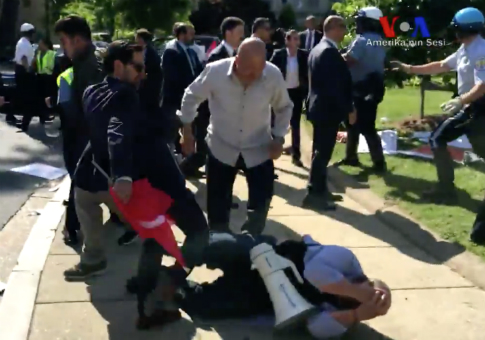 40 congressmen write letter advocating for turkish personnel assailants kick a protester outside the residence of the turkish ambassador in washington dc still from voice of america expocarfo Images