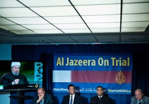 David Pollock, fellow at the Washington Institute, Mohamed Fawzi, former Al Jazeera English cameraman, Mohamed Fahmy, Al Jazeera English reporter, and lawyer Martin McMahon hold a press conference at the National Press Club about a lawsuit against Qatar's Al Jazeera June 22