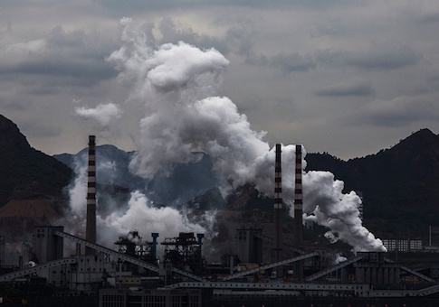 Smoke and steam billow from a Chinese state owned steel plant on June 2, 2017 in Hebei
