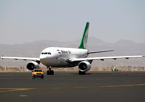 An airplane of Mahan Air sits at the tarmac