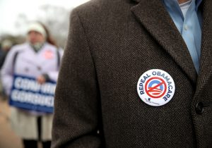 A protester wears a Repeal Obamacare button on his jacket