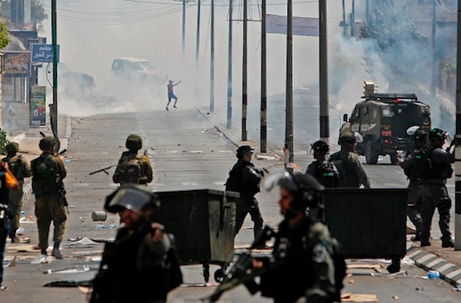 Tear gas fumes billow during clashes between Palestinian protesters and Israeli forces