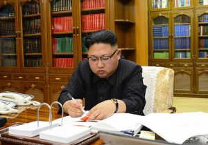 Kim Jong-Un signs the order to carry out the test-fire of the intercontinental ballistic missile Hwasong-14 at an undisclosed location