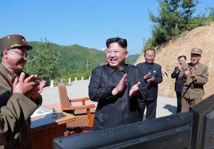 North Korean leader Kim Jong-Un celebrates the successful test-fire of the intercontinental ballistic missile Hwasong-14 at an undisclosed location
