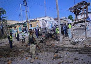 Somali soldiers attend the scene of a suicide car bomb attack linked to al Qaeda