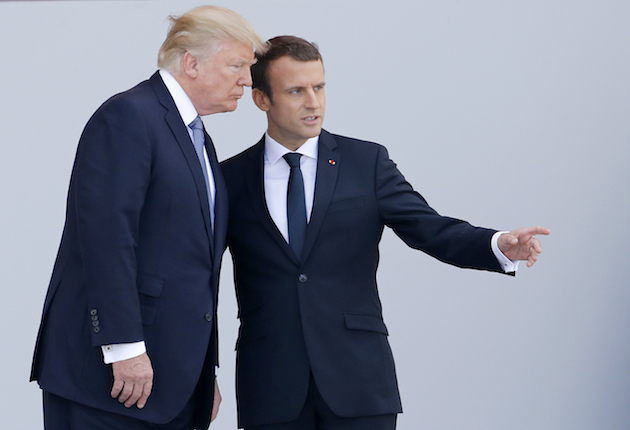 President Donald Trump and French President Emmanuel Macron attend the traditional Bastille day military parade on the Champs-Elysees on July 14