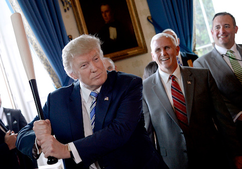 """President Donald Trump swings a Marucci baseball bat in the Blue Room during a """"Made in America"""" product showcase event at the White House"""