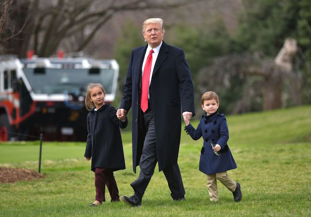US President Donald Trump makes his way to board Marine One with grandchildren Arabella Kushner and Joseph Kushner