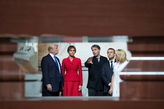 US President Donald Trump, First lady Melania Trump, French President Emmanuel Macron, and his wife Brigitte Macron listen to the Director of the Army Museum, David Guillet, as they visit Napoleon Bonapartes tomb at Les Invalides in Paris, on July 13