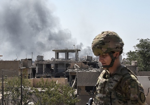 A U.S. soldier advising Iraqi forces is seen in the city of Mosul