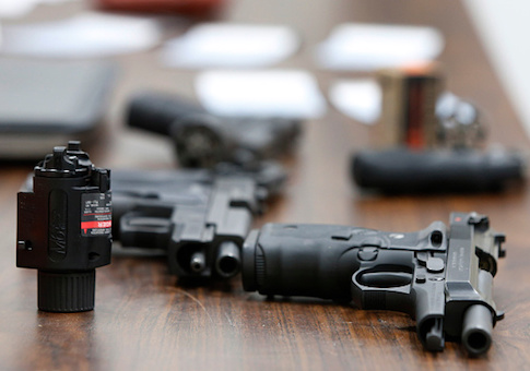 Several guns lay on a table during a class to obtain the Utah concealed gun carry permit