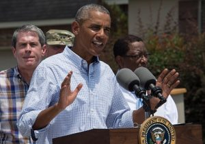 US President Barack Obama speaks after touring a flood-affected area in Baton Rouge, Louisiana, on August 23, 2016 / Getty Images