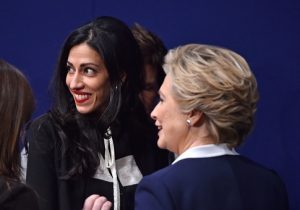 Huma Abedin with Hillary Clinton / Getty Images