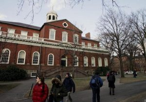Harvard students walk through the campus