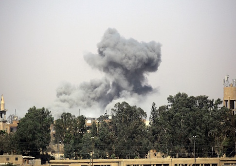 Smoke billows in Raqa's western al-Darya neighborhood