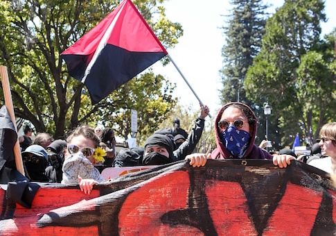 Antifa members and counter protesters gather during a rightwing No-To-Marxism rally in Berkeley, California