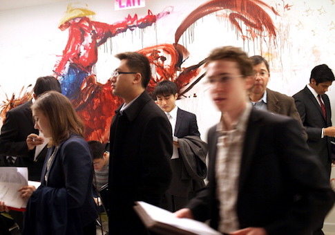 Job seekers attend a job fair