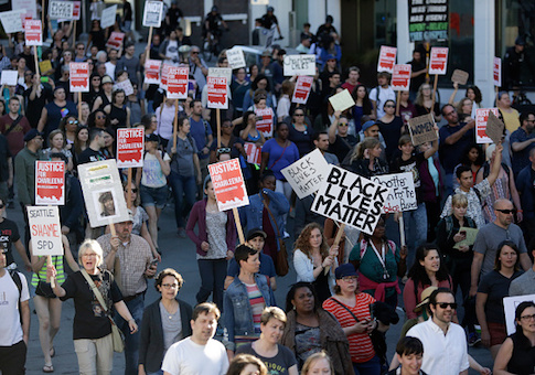 People march in protest to the fatal police shooting of Charleena Lyles, in Seattle