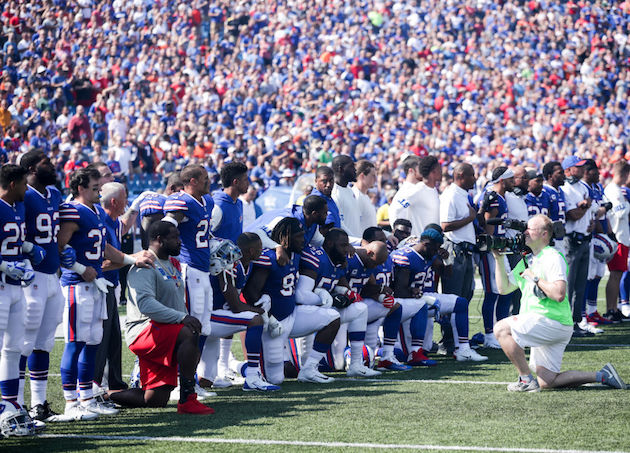 Marcell Dareus of the Buffalo Bills kneels during the American National anthem before an NFL game against the Denver Broncos