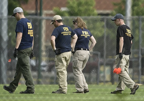 FBI and other law enforcement officials inspect a crime sceneFBI and other law enforcement officials inspect a crime scene