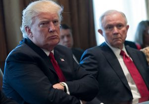 Donald Trump (L) and Attorney General Jeff Sessions (R) attend a panel discussion on an opioid and drug abuse in the Roosevelt Room of the White House March 29, 2017 in Washington, DC. / Getty Images